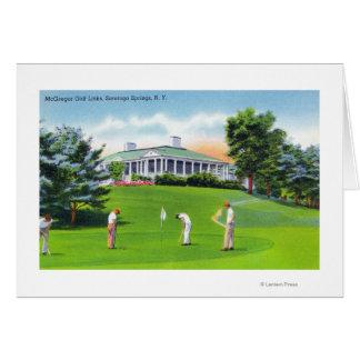 Golfeurs sur la scène de terrain de golf de McGreg Carte De Vœux