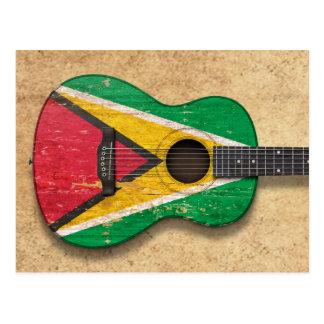 Guitare acoustique âgée et utilisée de drapeau de carte postale