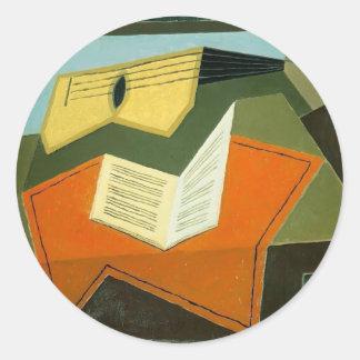 Guitare de Juan Gris- et papier de musique Autocollant Rond