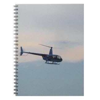 Hélicoptère rouge R44 et blanc Carnets