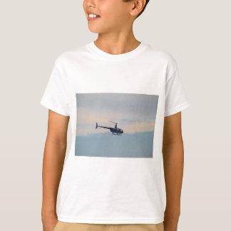 Hélicoptère rouge R44 et blanc T-shirt