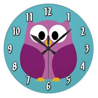 Hibou mignon de bande dessinée dans des couleurs l grande horloge ronde