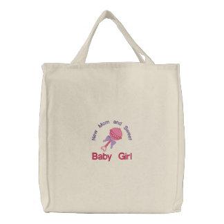 Hochet de bébé - rose sac brodé