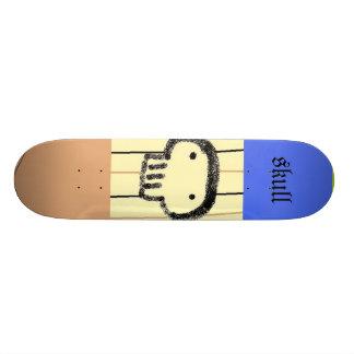 homme de crâne skateboards customisés