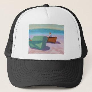 Homme s'asseyant dans le bateau, casquette