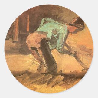 Homme se penchant avec le bâton ou la pelle, sticker rond