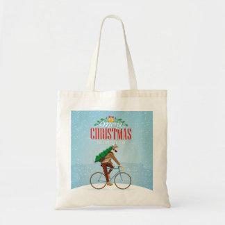Homme sur une bicyclette dans Noël d'hiver Tote Bag