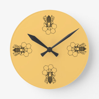 Horloge - abeille de miel sur le peigne
