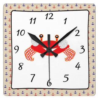 Horloge bleue rouge nautique de crabe d'ancres