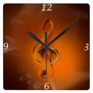 Horloge Carrée Le beau feu rougeoyant frais colore la musique d'e