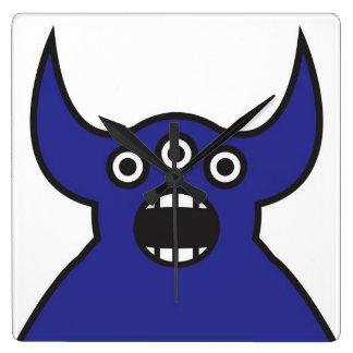 Horloge Carrée Visage étranger bleu de monstre de Kawaii