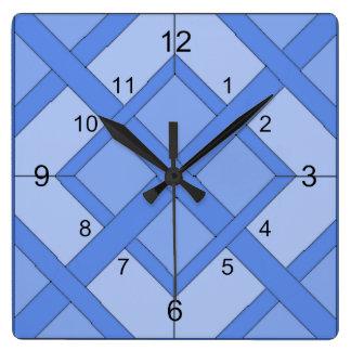 Horloge - carrés entrelacés dans le bleu