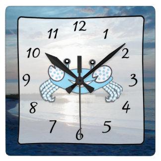 Horloge de crabe de plage de vue d'océan de