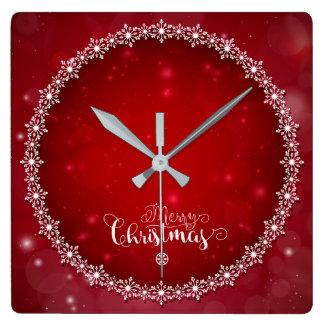 Horloge de Noël brouillée par rouge décoratif de
