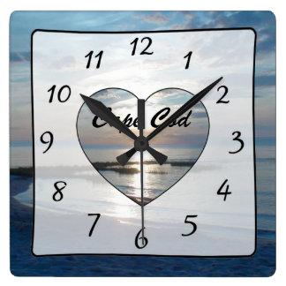 Horloge de plage de vue d'océan de coucher du