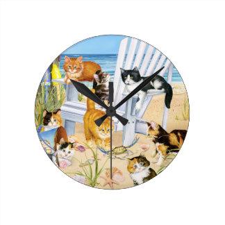 Horloge murale de chatons de plage
