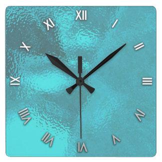 Horloge murale en verre bleue de regard d'Aqua