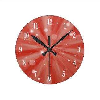 Horloge Ronde Starburst et neige de fête rouges