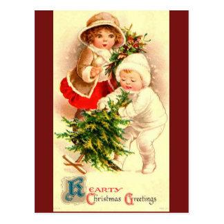 Image vintage mignonne d'enfants de Noël sur la Carte Postale