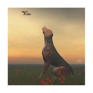 Impression Sur Bois Chien bronzage de noir regardant un vol d'oiseau