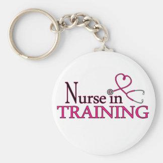 Infirmière dans la formation - rose porte-clé rond