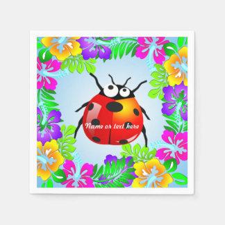 Insecte hawaïen de dame sur les fleurs colorées de serviettes jetables