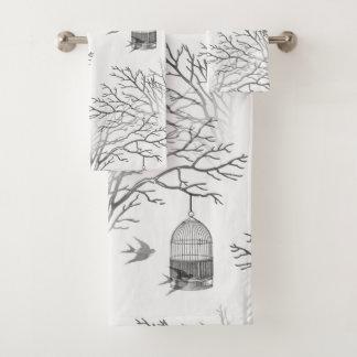 La branche nue de cage à oiseaux vintage avale