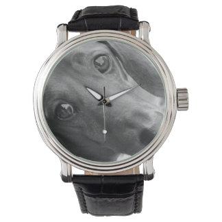 La montre de l'amoureux des chiens noir et blanc