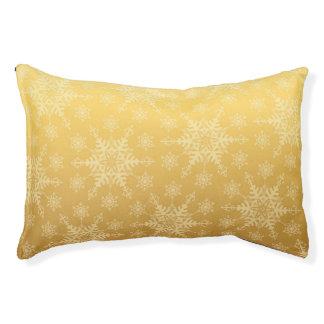 La neige d'or s'écaille pour le lit de chien de