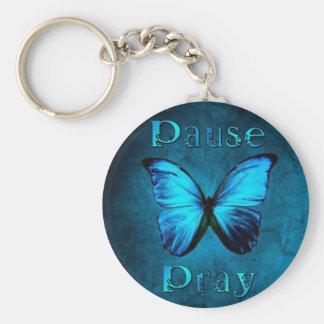 La pause prient le papillon bleu porte-clés