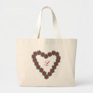 La poinsettia fleurit les sacs en forme de coeur