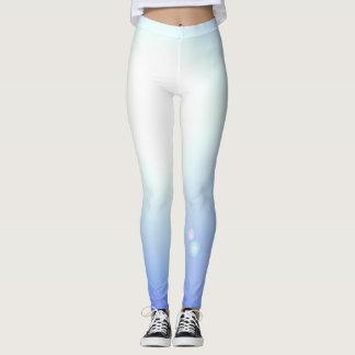 La séance d'entraînement blanche bleue de guêtres leggings