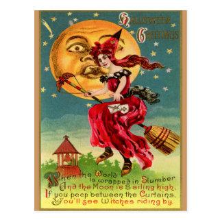 La sorcière vintage dans une robe rouge ou est ce carte postale