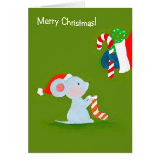 La souris rencontre la carte de Père Noël