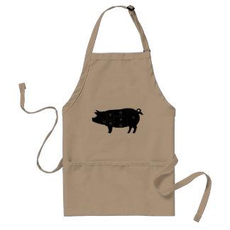 La viande de porc coupe des cadeaux de boucherie tablier