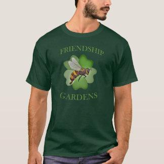 L'amitié fait du jardinage vert de T-shirt de logo