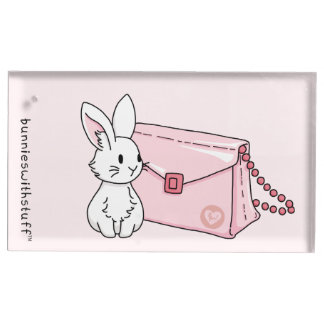 Lapin avec une bourse rose porte-cartes de placement