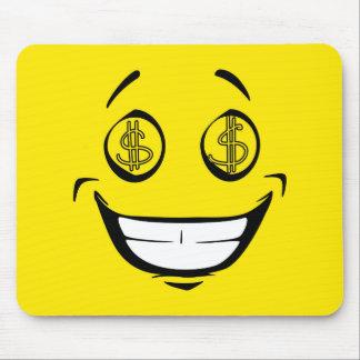 L'argent avide observe le visage souriant jaune tapis de souris