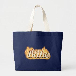 """""""le bébé chaud"""" flambe le sac fourre-tout d'or et"""