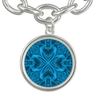 Le bracelet vintage de charme de motif de bleus