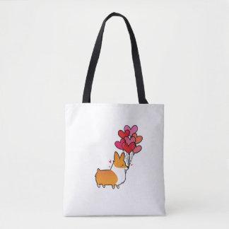 Le coeur de corgi monte en ballon le sac