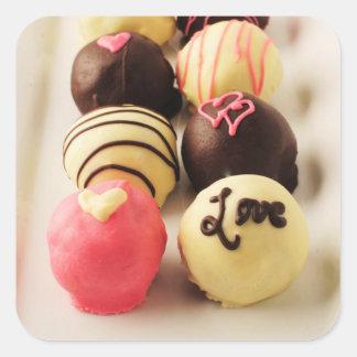 Le gâteau mord l'amour sticker carré