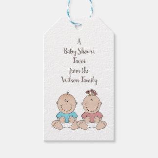 Le genre de deux bébés indiquent des étiquettes de