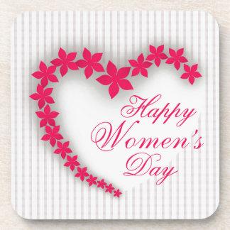 Le jour des femmes heureuses avec le coeur de dessous-de-verre