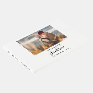 Le livre d'invité de mariage de photo, ajoutent
