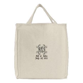Le monogramme de mariage appelle le sac de sacs brodés