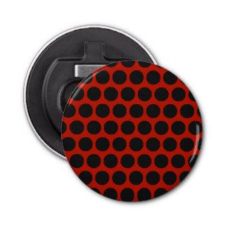 Le noir pointille l'ouvreur rond rouge décapsuleur