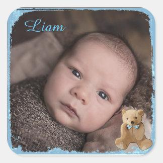 Le nom du bébé et l'autocollant de photo sticker carré