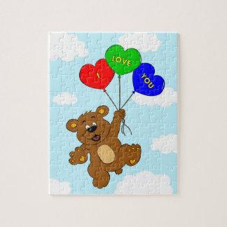 """Le """"ours dans l'amour"""" badine le puzzle"""