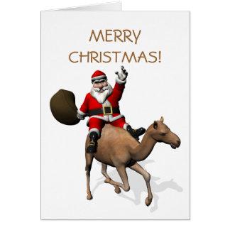 Le père noël montant un chameau carte de vœux